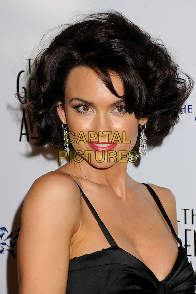 KELLY CARLSON .24th Annual Genesis Awards - Arrivals held at the Beverly Hilton Hotel, Beverly Hills, California, USA, 20th March 2010..portrait headshot black red lipstick make-up earrings dangly .CAP/ADM/BP.©Byron Purvis/AdMedia/Capital Pictures.