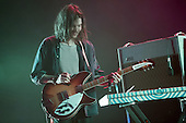 Tame Impala - Dominic Simper on guitar - performing live at The Hammersmith Apollo, London UK - 25 June 2013.   Photo credit: Justin Ng/Music Pics Ltd/IconicPix