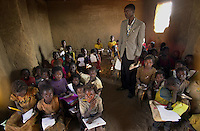 "A group of children in their school  at the ""New Hope"" refugee camp in Nabuangongo, Angola, some 20 kilometers (12 miles) northeast of Luanda, Friday, June 8, 2002. Many of the children suffer from malnutrition and depend solely on international aid. Approximately 25,000 refugees from Angola's 30-year civil live at the camp. Ross Mountain, deputy head of the U.N. Office for Coordination of Humanitarian Affairs, said Thursday that Angola was in bad shape with a ""catastrophic nutritional situation among children..Photo/Marcelo Hernandez"