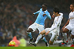 Swansea's Ki Sung-yueng tackles Bacary Sagna of Manchester City - Manchester City vs Swansea - Barclays Premier League - Etihad Stadium - Manchester - 12/12/2015 Pic Philip Oldham/SportImage