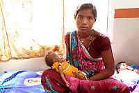 Kali has been referred with her severely malnourished daughter to the Nutrition Rehabilitation Centre in Badnavar, Dhar District of Madhya Pradesh. Her baby is two months old but weighed just 1.8kgs when she arrived at the centre five days ago. Kali is from a tribal area where it is still custom for babies to not be breastfed until they are a few days old. As a result many children are malnourished almost from birth. The Nutrition Rehabilitation Centres run  by the Government of Madya Pradesh are supported by UK aid from the Department for International Development.