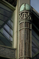 Tropical Rainforest Glasshouse (formerly Le Jardin d'Hiver or Winter Gardens), 1936, René Berger, Jardin des Plantes, Museum National d'Histoire Naturelle, Paris, France. Detail of wrought iron decoration made by Raymond Subes at the top of the luminescent glass paste pillars by Auguste Labouret on either side of the Art Deco style main entrance.