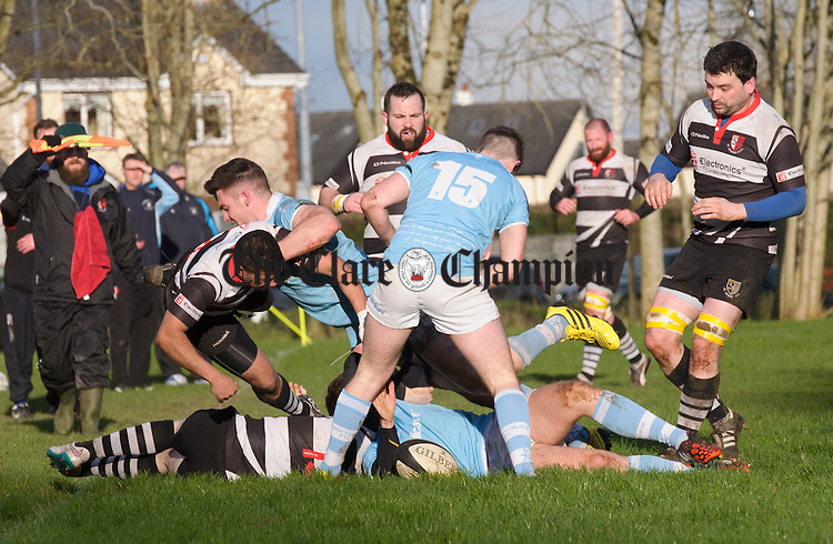 14 of St Senan's is thrown from the ruck by Elliot Fitzgerald of Garryowen during their  Munster Junior Cup game at Slattery park. Photograph by John Kelly.
