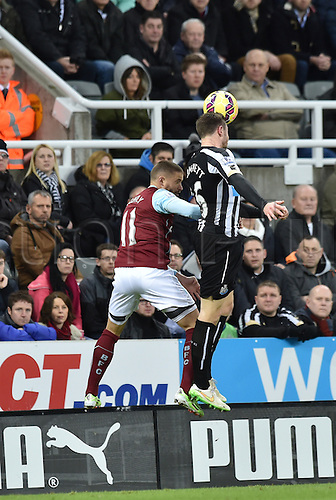 01.01.2015.  Newcastle, England. Barclays Premier League. Newcastle versus Burnley. Paul Dummett of Newcastle United and Michael Kightly of Burnley challenge in the air for the ball