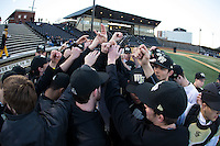 The Wake Forest Demon Deacons huddle up prior to the start of their game against the Georgetown Hoyas at David F. Couch Ballpark on February 19, 2016 in Winston-Salem, North Carolina.  The Demon Deacons defeated the Hoyas 3-1.  (Brian Westerholt/Four Seam Images)