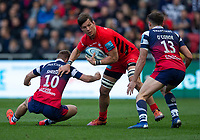 Saracens' Michael Rhodes is tackled by Bristol Bears' Callum Sheedy<br /> <br /> Photographer Bob Bradford/CameraSport<br /> <br /> Gallagher Premiership - Bristol Bears v Saracens - Saturday 13th April 2019 - Ashton Gate - Bristol<br /> <br /> World Copyright © 2019 CameraSport. All rights reserved. 43 Linden Ave. Countesthorpe. Leicester. England. LE8 5PG - Tel: +44 (0) 116 277 4147 - admin@camerasport.com - www.camerasport.com