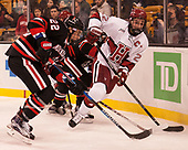 Tanner Pond (NU - 22), Devin Tringale (Harvard - 22) - The Harvard University Crimson defeated the Northeastern University Huskies 4-3 in the opening game of the 2017 Beanpot on Monday, February 6, 2017, at TD Garden in Boston, Massachusetts.
