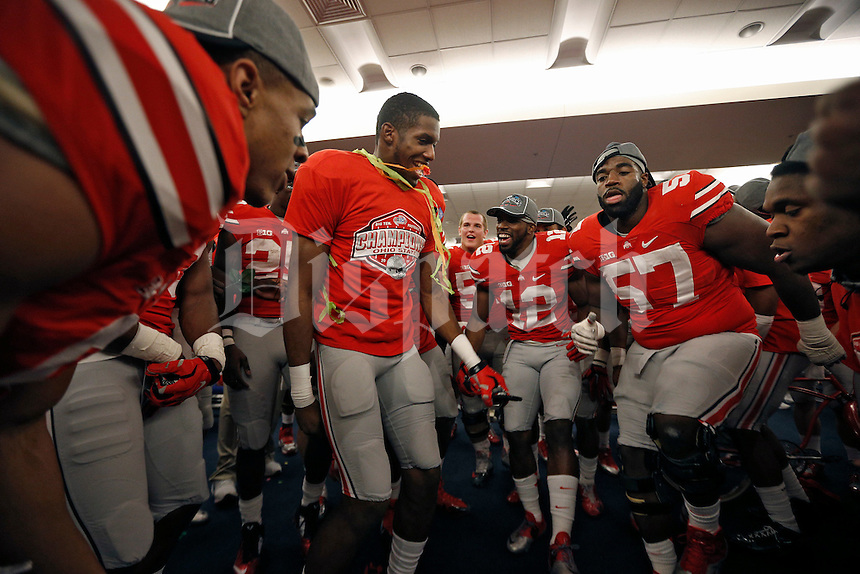 Ohio State Buckeyes offensive lineman Chase Farris (57) celebrate after beating Wisconsin Badgers in the 2014 Big Ten Football Championship Game at Lucas Oil Stadium in Indianapolis, Ind. on December 6, 2014.  (Dispatch photo by Kyle Robertson)