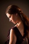 Young woman in profile with eyes closed