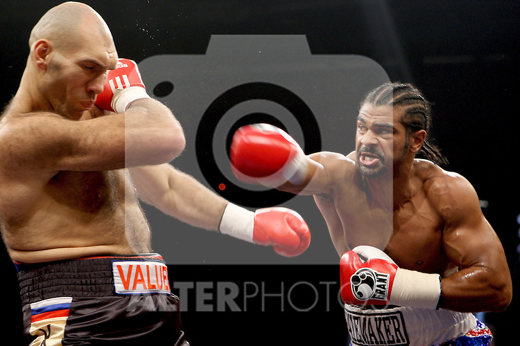 British challenger David Haye trades punches with Russian WBA heavyweight champion Nikolai Valuev in their WBA heavyweight boxing world champion match in the southern German city of Nuremberg on November 7, 2009. Haye claimed the WBA heavyweight title on with a shock majority decision win against Valuev over 12 rounds.