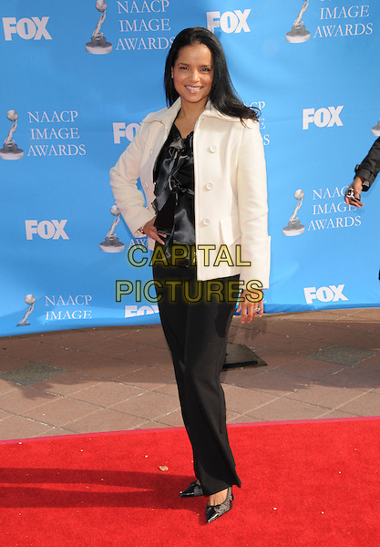 VICTORIA ROSS.Attends The 39th NAACP Image Awards held at The Shrine Auditorium in Los Angeles, California, USA..February 14th, 2008        .full length black trousers top white jacket hand on hip                                            .CAP/DVS.©Debbie VanStory/Capital Pictures.