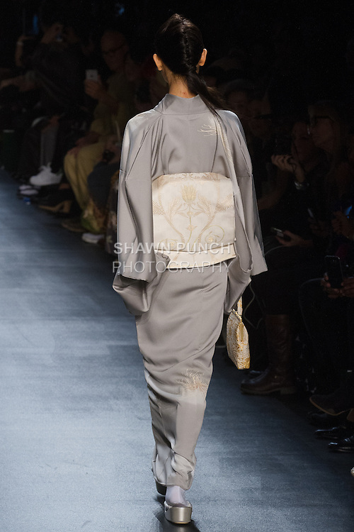 """Model walks runway in an """"Existence of wind"""" silk kimono from the Hiromi Asai Fall Winter 2016 """"Spirit of the Earth"""" collection by Hiromi Asai & Kimono Artisan Kyoto, presented at NYFW: The Shows Fall 2016, during New York Fashion Week Fall 2016."""