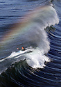 Rainbow colors can be seen in the spray being blown back off the lip of a wave as a surfer punches through the wave on the north side of the Oceanside Pier in 2012. photo for North County Times