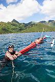 FRENCH POLYNESIA, Moorea Island. Spearfisherman at Opunohu Bay.