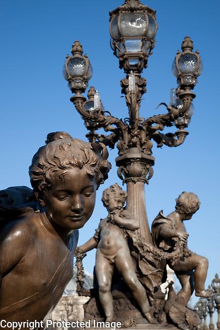 Figure on Alexandre III Bridge, Paris, France