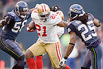 San Francisco 49ers running back Frank Gore stiff arms Seattle Seahawks  cornerback Richard Sherman (25) while running past linebacker Leroy Hill (56) at CenturyLink Field in Seattle, Washington on December 24, 2011.  The 49ers came from behind to beat the Seahawks 19-17. ©2011 Jim Bryant Photo. All Rights Reserved.