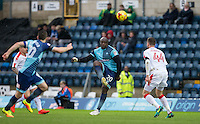 Adebayo Akinfenwa of Wycombe Wanderers heads forward during the Sky Bet League 2 match between Wycombe Wanderers and Crawley Town at Adams Park, High Wycombe, England on 25 February 2017. Photo by Andy Rowland / PRiME Media Images.