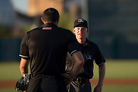 Field umpire Austin Nelson talks to home plate umpire Alan Gorewitz before an Arizona League game between the AZL Reds and the AZL Cubs 2 at Sloan Park on June 18, 2018 in Mesa, Arizona. AZL Cubs 2 defeated the AZL Reds 4-3. (Zachary Lucy/Four Seam Images)