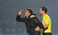 The linesman holds back Ricardo Moniz Manager of Notts County during the Sky Bet League 2 match between Wycombe Wanderers and Notts County at Adams Park, High Wycombe, England on 15 December 2015. Photo by Andy Rowland.