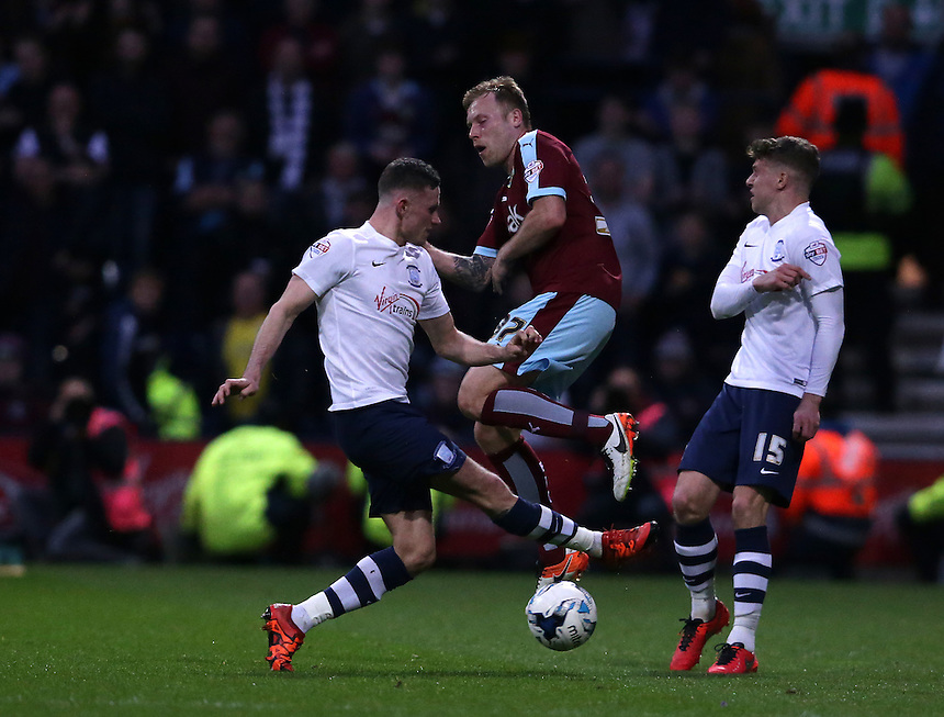 Preston North End's Alan Browne (left) and Calum Woods (right) battles with Burnley's Scott Arfield<br /> <br /> Photographer Stephen White/CameraSport<br /> <br /> Football - The Football League Sky Bet Championship - Preston North End v Burnley - Friday 22nd April 2016 - Deepdale - Preston <br /> <br /> &copy; CameraSport - 43 Linden Ave. Countesthorpe. Leicester. England. LE8 5PG - Tel: +44 (0) 116 277 4147 - admin@camerasport.com - www.camerasport.com