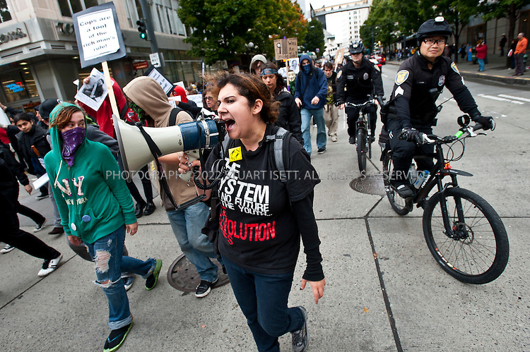 10/22/2011--Seattle, WA, USA..Occupy Seattle, a spin off of the Occupy Wall Street protests in New York City, joined an anti-police brutality march in downtown Seattle with over 500 protesters, including a few black masked anarchists and other radicals. The Occupy Seattle protest has attempted to set up a base in Seattle's Westlake Park in the heart of the city but the Seattle Police Department has arrested anyone attempting to set up tents...©2011 Stuart Isett. All rights reserved.