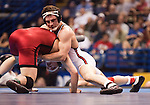 March 21 2009       Jarrod King from Edinboro (white) battles Andrew Howe from Wisconsin (red) in the 165 pound weight class in the championship round of the NCAA Division I  Wrestling Championships which were held March 19 through March 21, 2009 at the Scottrade Center in downtown St. Louis, Missouri.  King defeated Howe...         *******EDITORIAL USE ONLY*******