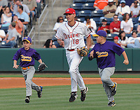 Shortstop Derrik Gibson (18) of the Greenville Drive runs onto the field with two youth ballplayers prior to a game on May 20, 2010, at Fluor Field at the West End in Greenville, S.C. Photo by: Tom Priddy/Four Seam Images