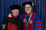 The Rev. Christopher Robinson, C.M., left, and the Rev. Dennis H. Holtschneider, C.M., president of DePaul. DePaul University School of Music and The Theatre School held its commencement ceremony, Saturday, June 10, 2017, during the DePaul University School of Music and The Theatre School commencement ceremony at the Rosemont Theatre in Rosemont, IL. (DePaul University/Jeff Carrion)