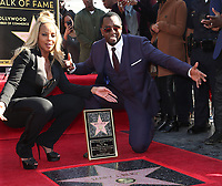 HOLLYWOOD, CA - JANUARY 11: Sean 'Diddy' Combs pictured as Mary J. Blige receives a star on Hollywood Walk Of Fame in Hollywood, California on January 11, 2018. <br /> CAP/MPIFS<br /> &copy;MPIFS/Capital Pictures