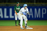 Kyle Datres (3) of the North Carolina Tar Heels celebrates as he stands on second base after hitting an RBI double against the Miami Hurricanes in the second semifinal of the 2017 ACC Baseball Championship at Louisville Slugger Field on May 27, 2017 in Louisville, Kentucky.  The Tar Heels defeated the Hurricanes 12-4.  (Brian Westerholt/Four Seam Images)