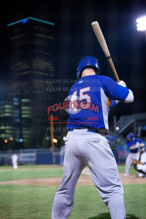 August 19,2010 Petey Paramore (45) on deck under the Tulsa skyline during the MiLB game between the Midland RockHounds and the Tulsa Drillers at OneOk Field in Tulsa Oklahoma.