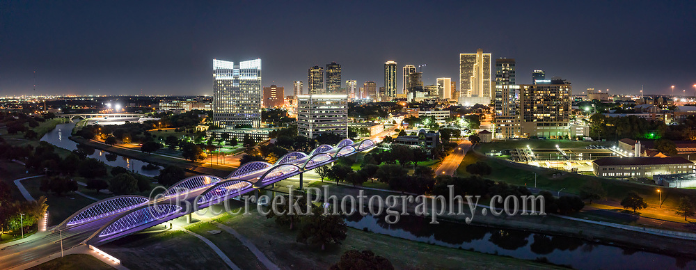 Another panorama aerial capture of the Fort Worth skyline at night. Love the purple lights on the seventh street bridge which connects the University area with the downtown across the Trinity River. Fort Worth is the fifth largest city in Texas. Ft Worth is located in central north part of Texas and the county seat is Tarrant County. The latest census is that the population for Fort Worth is estimates, at around 854,113. The city is the second-largest in the Dallas–Fort Worth–Arlington metropolitan area or the DFW Metro.