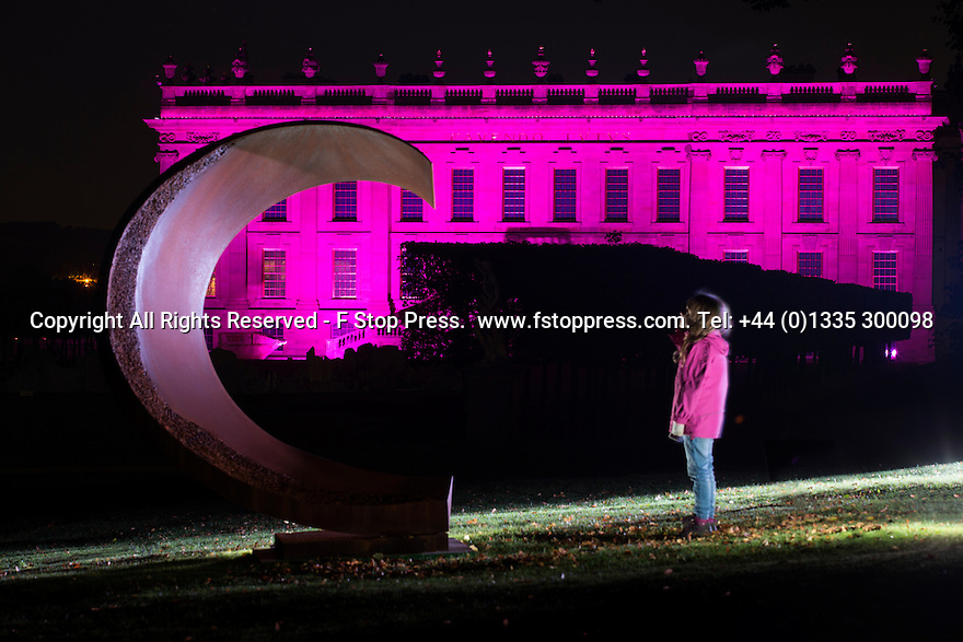 04/10/14 <br /> <br /> A young visitor admires a statue while Chatsworth House in bathed in pink light.<br /> <br /> Luminaire returns to Chatsworth Hose. <br /> <br /> In the garden an illuminated trail leads the way, inspired by the drawings of Inigo Jones. Moments from the Masque of Oberon, The Fairy Prince, feature along the trail, with lighting, projections and music.<br /> <br /> A selection of drawings from the Masque, illustrated by Inigo Jones (1611) and other colourful drawings by Inigo Jones will be displayed in the Great Chamber. Not seen in over 40 years, these drawings along with music bring the Baroque house to life.<br /> <br /> Luminaire in the house and garden is open each evening until October 7th.<br /> <br /> All Rights Reserved - F Stop Press.  www.fstoppress.com. Tel: +44 (0)1335 300098