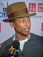 "NEW YORK CITY, NY, USA - APRIL 28: Recording Artist Pharrell Williams at the Pharrell Williams UNIQLO ""I Am Other"" Collection Launch held at the UNIQLO New York 5th Avenue Global Flagship Store on April 28, 2014 in New York City, New York, United States. (Photo by Jeffery Duran/Celebrity Monitor)"