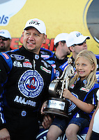 Apr. 3, 2011; Las Vegas, NV, USA: NHRA funny car driver Robert Hight celebrates with daughter Autumn Hight after winning the Summitracing.com Nationals at The Strip in Las Vegas. Mandatory Credit: Mark J. Rebilas-