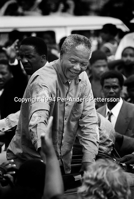 DURBAN, SOUTH AFRICA - APRIL 21: Nelson Mandela acknowledges a crowd of ANC supporters April 21, 1994 in Durban, South Africa. The pre-election rally was just days before the historic democratic election on April 27, 1994 that Mr. Mandela won. Mr. Mandela became the first black democratic elected president in South Africa. He retired from office after one term in June 1999. (Photo by Per-Anders Pettersson)