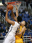 Nevada's AJ West shoots over Northwest Christian's Jay Mayernik during a college basketball game in Reno, Nev., on Sunday, Dec. 28, 2014. Nevada won 81-67.<br /> Photo by Cathleen Allison
