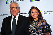 Kennedy Center Chairman David M. Rubenstein, chairman, John F. Kennedy Center for the Performing Arts, left, and daughter Ellie, right, arrive for the formal Artist's Dinner honoring the recipients of the 42nd Annual Kennedy Center Honors at the United States Department of State in Washington, D.C. on Saturday, December 7, 2019. The 2019 honorees are: Earth, Wind & Fire, Sally Field, Linda Ronstadt, Sesame Street, and Michael Tilson Thomas.<br /> Credit: Ron Sachs / Pool via CNP