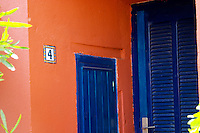 Collioure. Roussillon. A door. Blue against red ochre ochra wall. France. Europe.