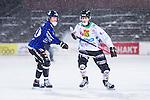 Uppsala 2014-01-12 Bandy  IK Sirius - GAIS Bandy :  <br /> GAIS Adam Rudell i kamp om bollen med i sn&ouml;v&auml;dret med Sirius Ted Wiklund <br /> (Foto: Kenta J&ouml;nsson) Nyckelord:  sn&ouml; sn&ouml;v&auml;der sn&ouml;yra v&auml;der