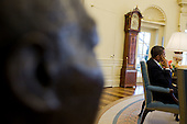 A bronze bust of Dr. Martin Luther King, Jr. is visible in the foreground as United States President Barack Obama meets with senior advisors, in the Oval Office, Thursday, February 4, 2010.  .Mandatory Credit: Pete Souza - White House via CNP