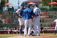 South Bend Cubs manager Jimmy Gonzalez (jacket) talks with pitcher Justin Steele (21) and catcher Tyler Alamo (22) during the second game of a doubleheader against the Peoria Chiefs on July 25, 2016 at Four Winds Field in South Bend, Indiana.  South Bend defeated Peoria 9-2.  (Mike Janes/Four Seam Images)