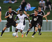 New England Revolution forward Kenny Mansally (7) shields  the ball against DC United midfielder Branko Boskovic (8) .    The New England Revolution defeated DC United 3-2 in US Open Cup match , at the Maryland SoccerPlex, Tuesday  April 26, 2011.