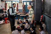 Father Laborde speaks to a teacher at Ekpranta Nagar School at Howrah. West Bengal, India, Arindam Mukherjee/Agency Genesis