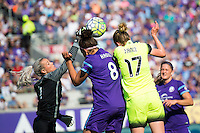 Orlando, Florida - Sunday, May 8, 2016: Orlando Pride goalkeeper Ashlyn Harris (1) punches the ball away from teammate Sarah Hagen (8) and Seattle Reign FC forward Beverly Yanez (17) during a National Women's Soccer League match between Orlando Pride and Seattle Reign FC at Camping World Stadium.