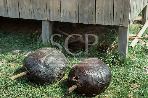 Xapuri, Acre State, Brazil. Two balls of smoked rubber on poles ready to sell.