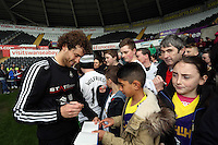 Wednesday, 23 April 2014<br /> Pictured: Jose Canas signing autographs for supporters.<br /> Re: Swansea City FC are holding an open training session for their supporters at the Liberty Stadium, south Wales,