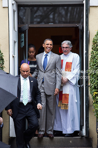 Reverend Dr. Luis Leon, right, looks on as United States President Barack Obama, left, prepares to leave St John's Episcopal Church after an Easter service, in Washington, Sunday, March 31, 2013..Credit: Drew Angerer / Pool via CNP