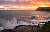 NEW ZEALAND, The Catlins, Waves crash on the Rocks at Sunset over Curio Bay, Ben M Thomas