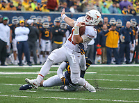 Morgantown, WV - November 18, 2017: Texas Longhorns quarterback Sam Ehlinger (11) gets tackled by a West Virginia Mountaineers defender during game between Texas and WVU at  Mountaineer Field at Milan Puskar Stadium in Morgantown, WV.  (Photo by Elliott Brown/Media Images International)